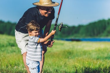 Grandfather with grandson fishing