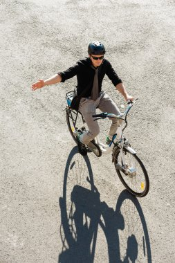 businessman riding on electric bicycle