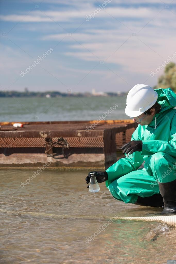 Environmentalist with sample of polluted water