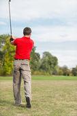 male Golfer with iron club