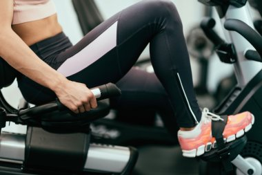female athlete in  gym cycle class