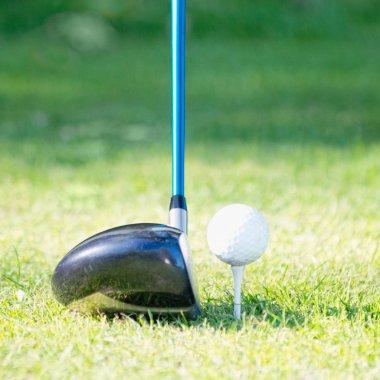 Driver club behind golfball