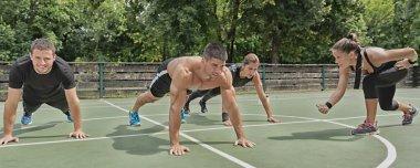 male athletes doing push ups