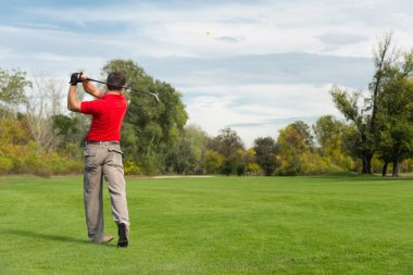 Golfer playing from fairway