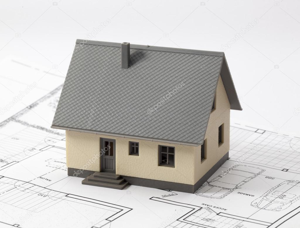 Building project still life with miniature house on blueprint building project still life with miniature house on blueprint stock photo malvernweather Images