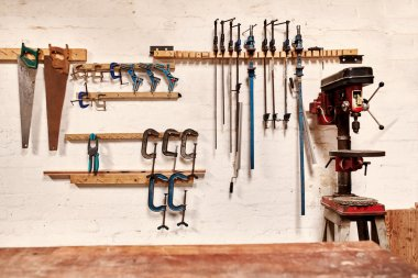 wall of woodwork workshop with hand tools