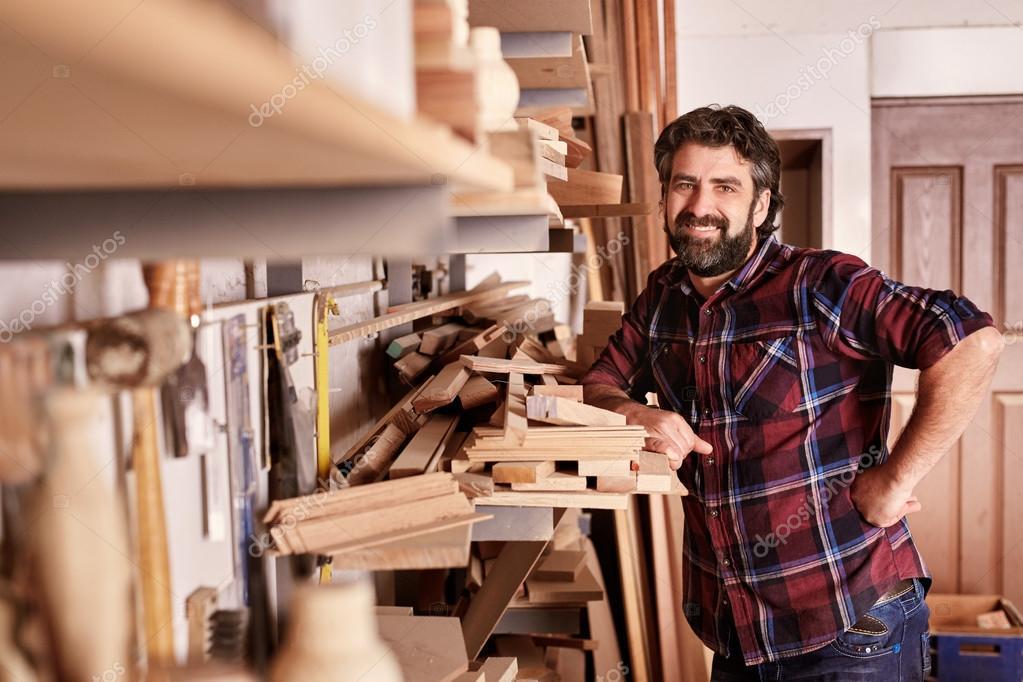 carpenter standing confidently in workshop