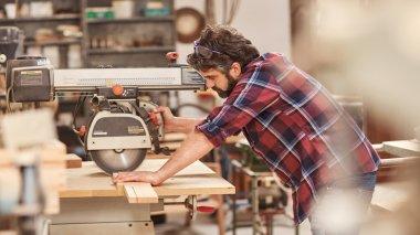 Craftsman using radial arm saw
