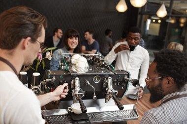Barista training to use an espresso machine