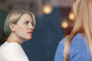 Woman listening carefully to friend