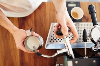 barista using espresso machine