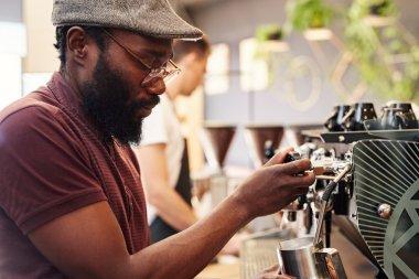 barista using modern espresso machine