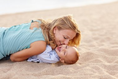 mother playing with laughing baby son