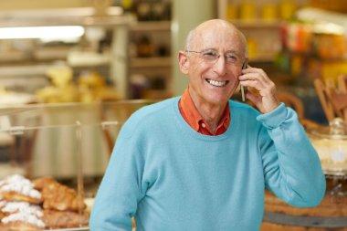 Deli owner talking on phone