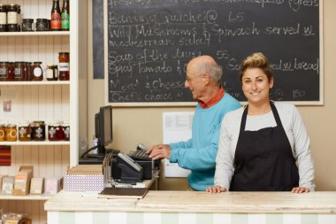 business owners standing behind counter
