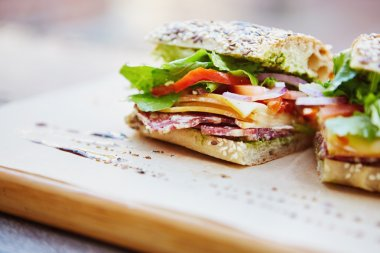 Healthy sandwiches on wooden board