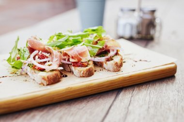 Fresh bruschetta with parma ham