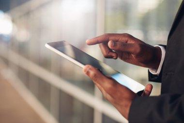 hands of businessman using digital tablet