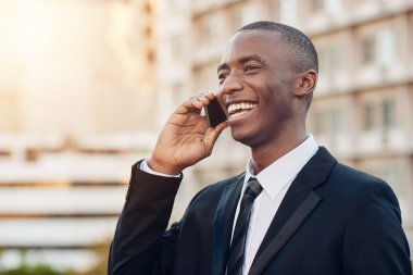 businessman talking on mobile phone in city