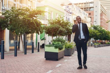 businessman talking on phone while walking