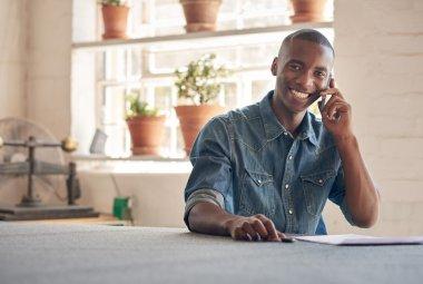 African man talking on mobile phone