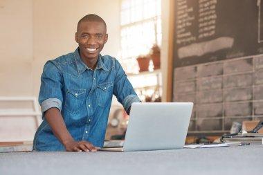 entrepreneur with laptop in studio