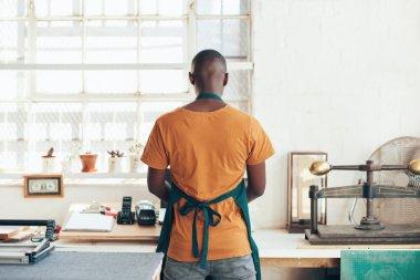 designer standing at work area