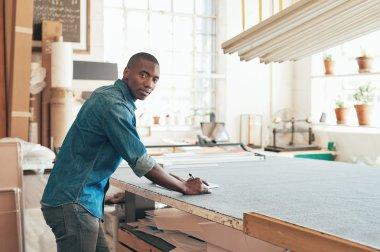 designer working at work table in studio