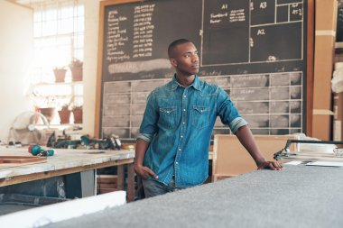 African designer looking away optimitsically