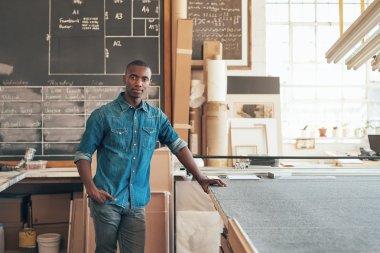 designer standing confidently in workshop studio