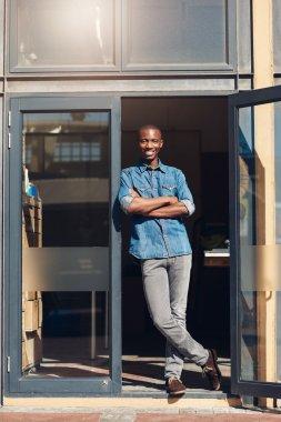 business owner in doorway of studio