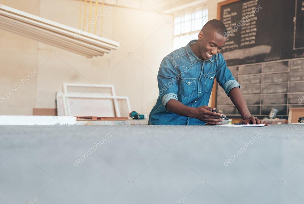 designer working on plans at studio table