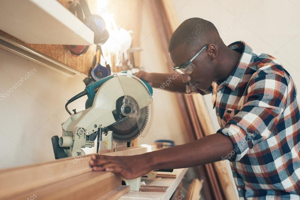 artisan working with chop saw in workshop — Stock Photo
