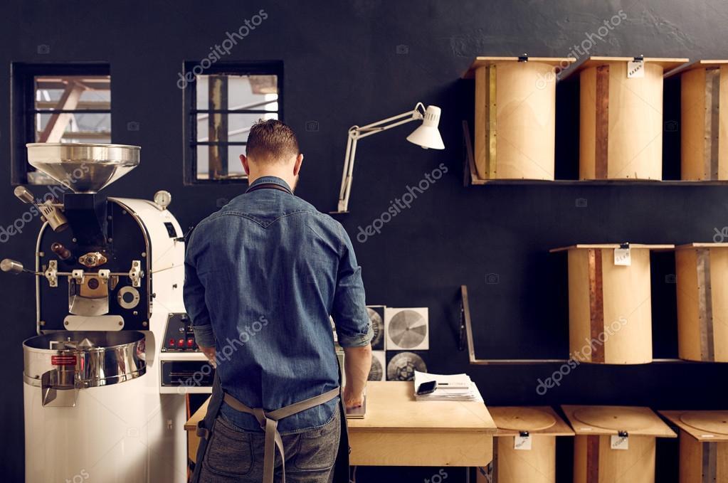man working in coffee roastery