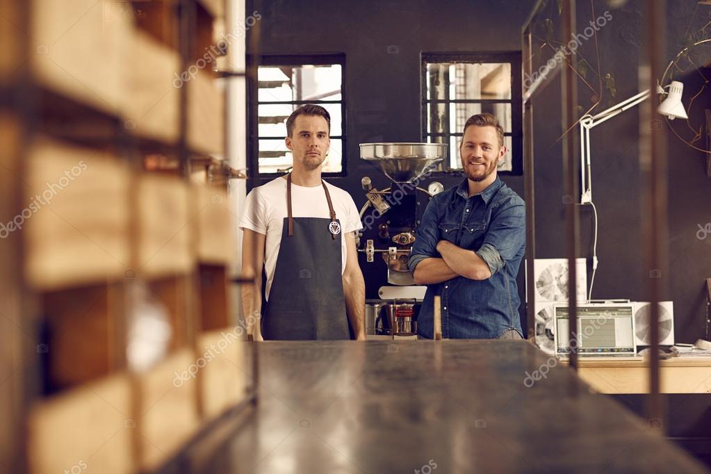 men in roast coffee beans workspace