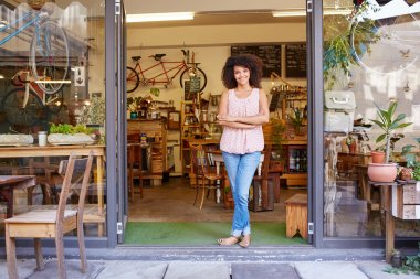Woman standing in entrance of coffee shop