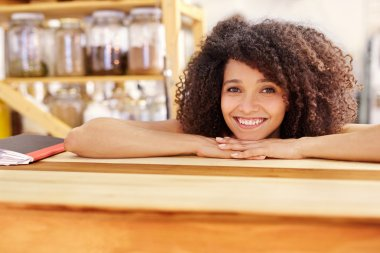 woman resting on wooden counter