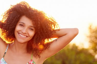 Woman smiling in park on summer evening