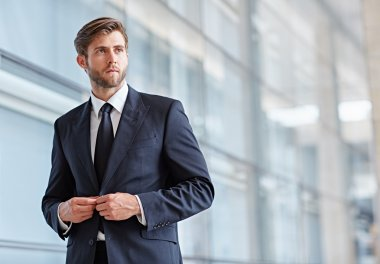 businessman looking seriously away