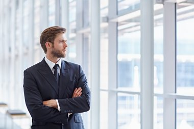 businessman looking confidently out