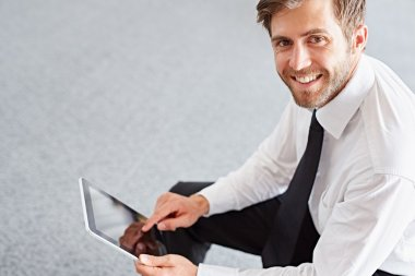 businessman using tablet at office coridor