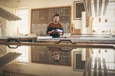Designer checking stock in studio