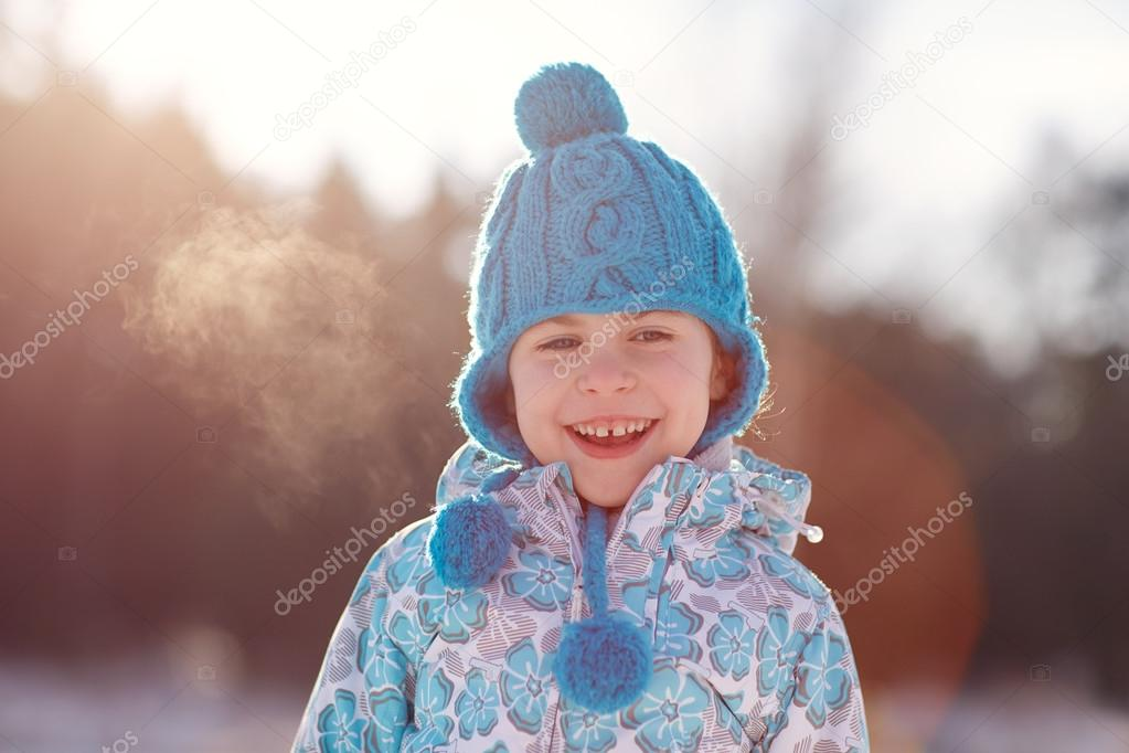 girl smiling outside on winter day