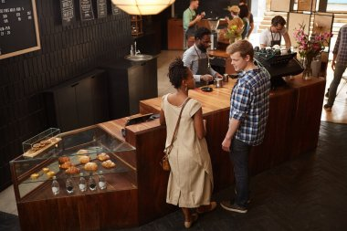 people chatting at modern wooden counter