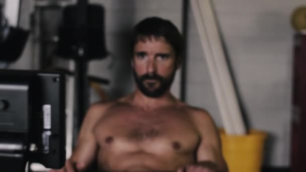 Muscular Athlete Does Intense Rowing