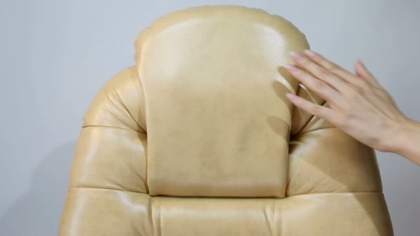 Female Hand Touching New Leather Office Boss Chair (armchair)