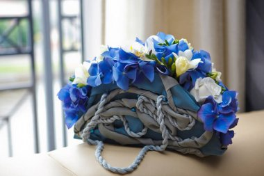 Brides bouquet of blue hydrangeas, lilies and roses in the form of handbags. Soft focus, selective focus