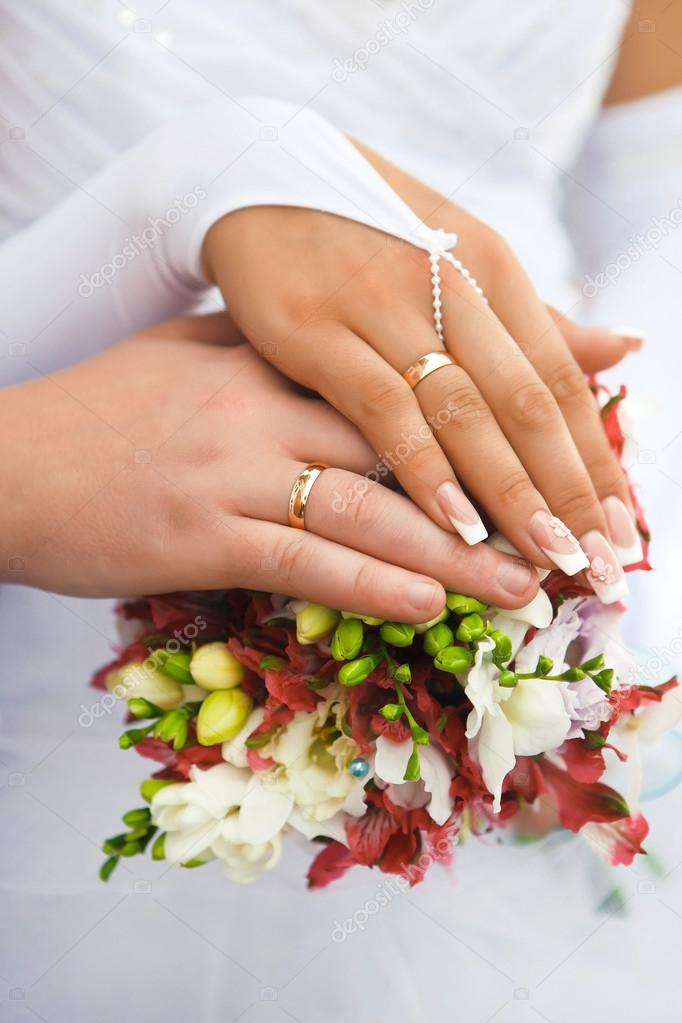 Hands Men And Women With Wedding Rings Stock Photo