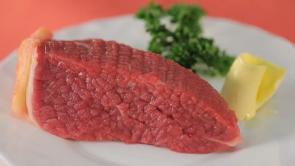 Fillet of fresh meat on white plate