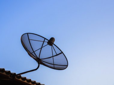 Satelite dish for digital television signal on the roof ot the h